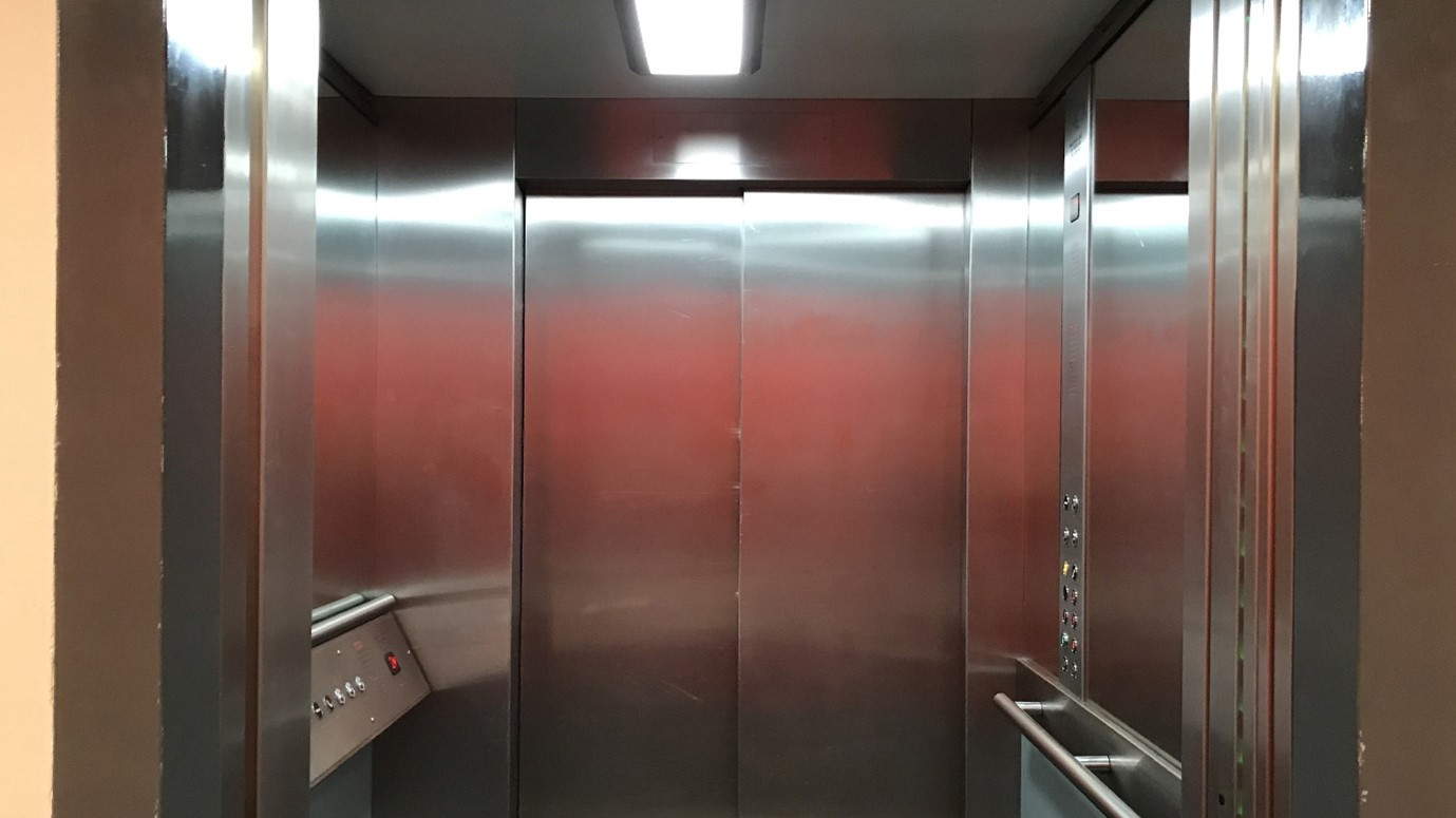 The silver interior of a lift at Sadler's Wells Theatre