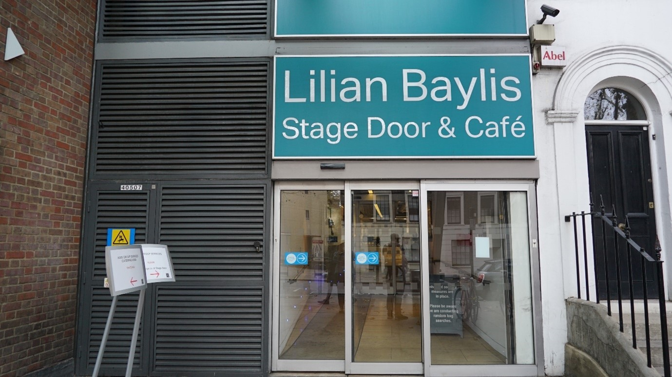 The entrance to the stage door of Sadler's Wells Theatre with automatic glass doors